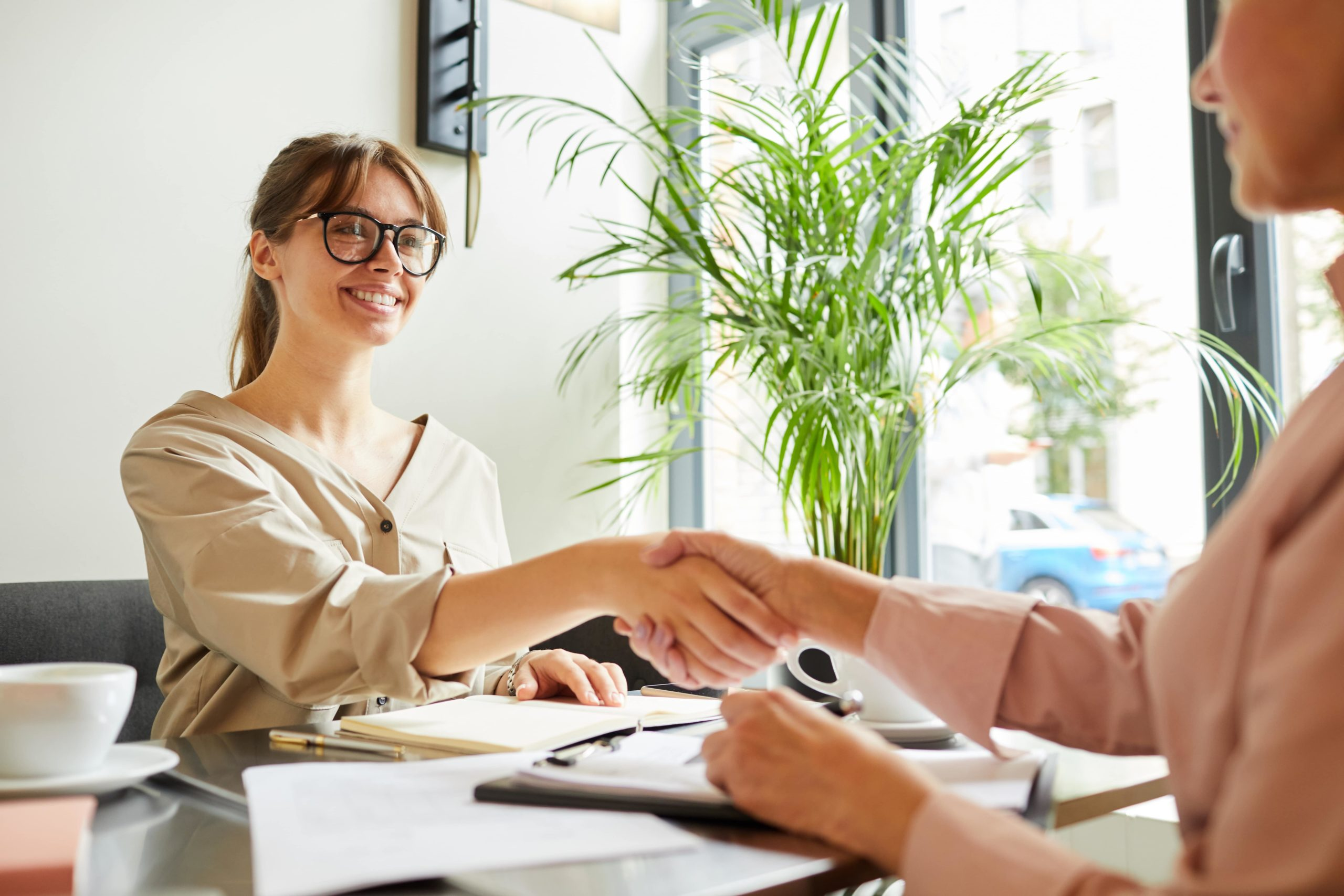 smiling woman shaking hands with lender