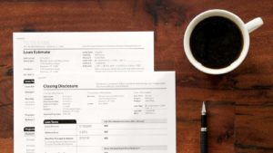 Paperwork (Mortgage) a pen and Coffee
